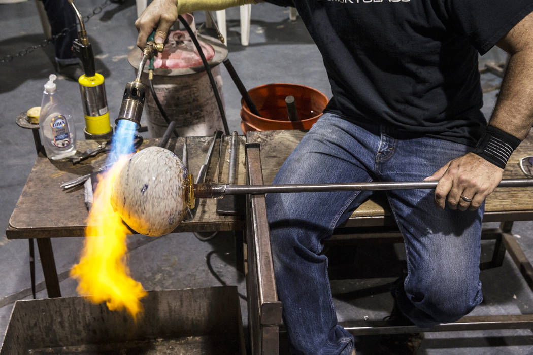 Artist Larry Domsky works with soft glass to make a platter during an open house on Thursday, April 6, 2017, at Domsky Glass, in Las Vegas. Domsky and his wife Barbara are resident artists at the  ...