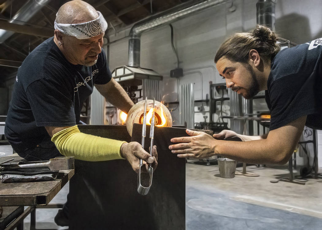 Artist Larry Domsky, left, and Matt Humphrey work with soft glass to make a platter during an open house on Thursday, April 6, 2017, at Domsky Glass, in Las Vegas. Domsky and his wife Barbara are  ...
