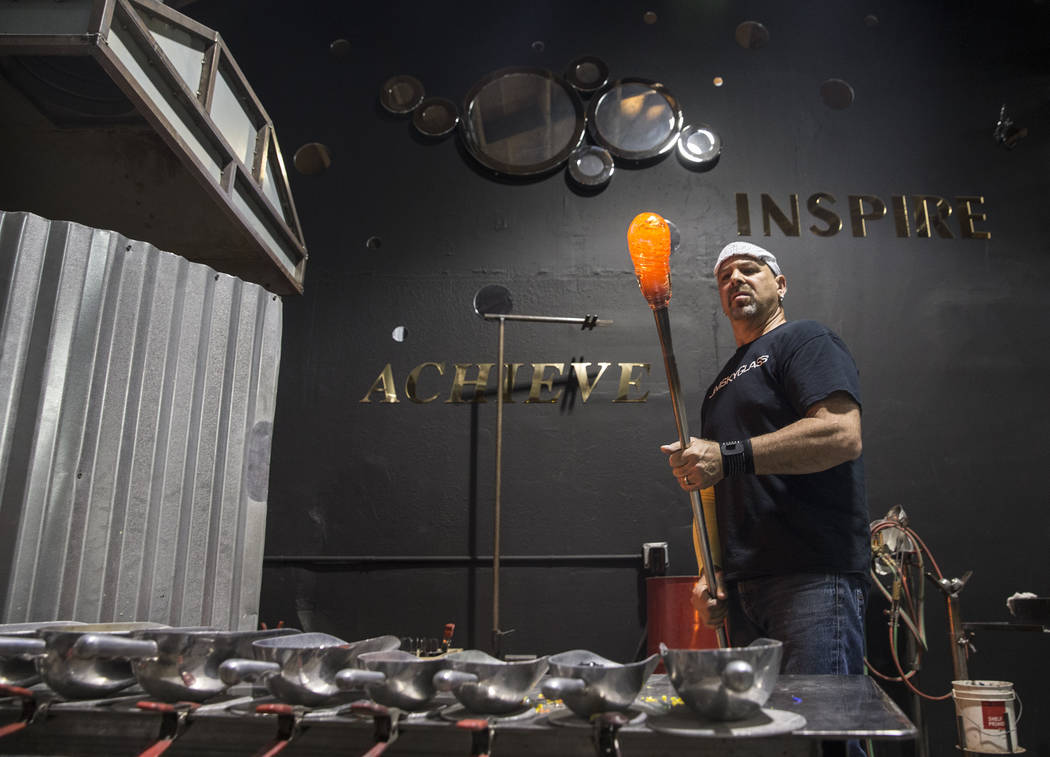 Artist Larry Domsky adds color to hot glass while making a platter during an open house on Thursday, April 6, 2017, at Domsky Glass, in Las Vegas. Domsky and his wife Barbara are resident artists  ...