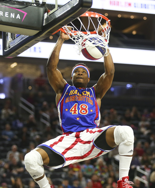"""Harlem Globetrotters forward Antjuan """"Clutch"""" Ball (48) dunks the ball while performing at T-Mobile Arena in Las Vegas on Thursday, Feb. 9, 2017. (Chase Stevens/Las Vegas Review- ..."""