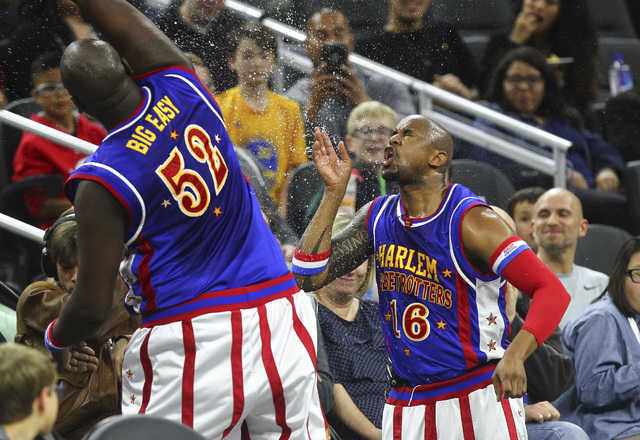 """Harlem Globetrotters' Nathaniel """"Big Easy"""" Lofton (52), left, and Shane """"Scooter"""" Christensen (16), a native of Las Vegas, perform at T-Mobile Arena in Las Vega ..."""