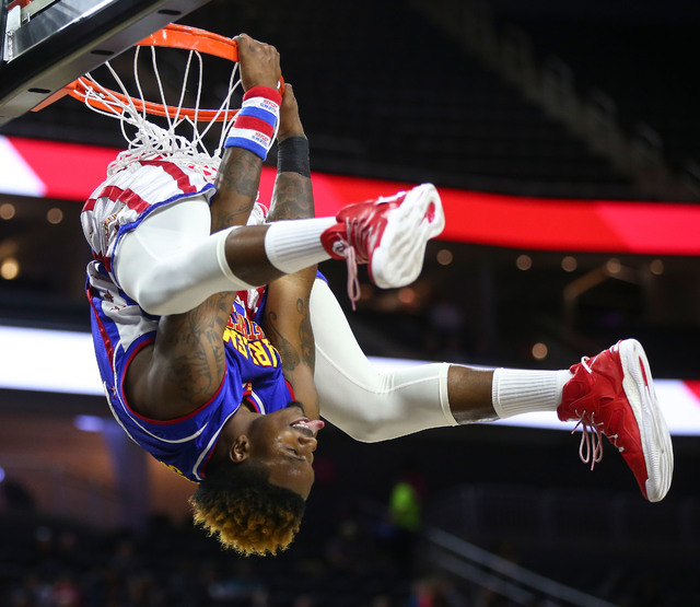 """Harlem Globetrotters forward Angelo """"Spider"""" Sharpless (42) hangs from the basket after dunking the ball at T-Mobile Arena in Las Vegas on Thursday, Feb. 9, 2017. (Chase Stevens/ ..."""