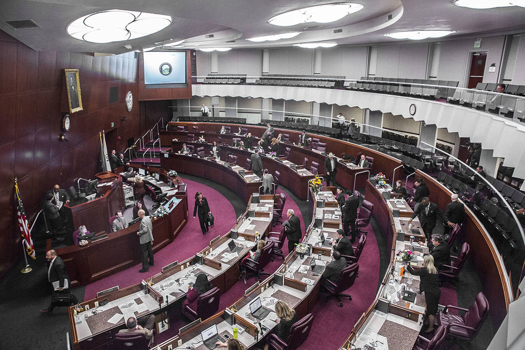 Members of the assembly file out of chambers during the second day of the Nevada Legislative session on Tuesday, Feb. 7, 2017, at the Legislative Building, in Carson City. (Benjamin Hager/Las Vega ...