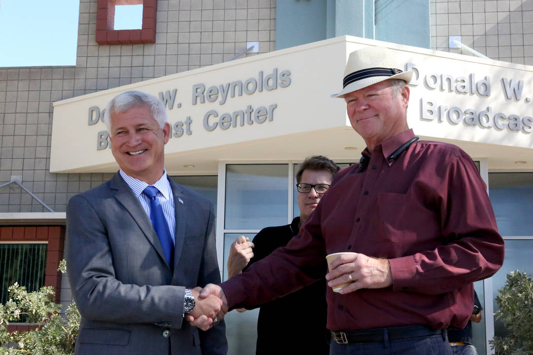 Col. Steve Seroka, left, and Councilman Bob Beers shake hands in front of the KNPR studios with senior producer Joe Schoenmann for a debate in the Las Vegas Ward 2 City Council race on Thursday, M ...