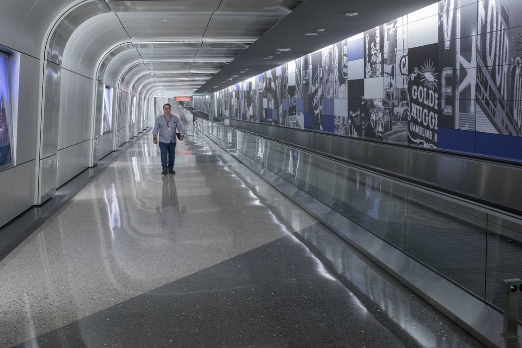 A man walks through the recently completed 995-foot-long corridor linking the D-Gate Concourse to the airport's U.S. Customs and Border Protection station in Terminal 3 at McCarran International A ...