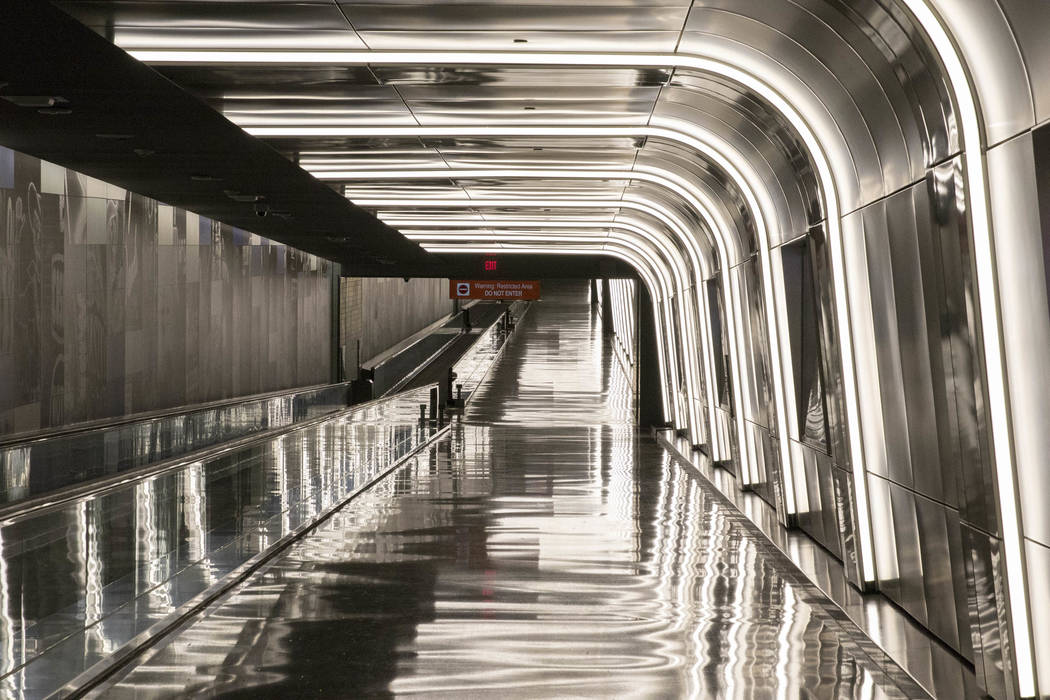 Light fixtures frame the recently completed 995-foot-long corridor linking the D-Gate Concourse to the airport's U.S. Customs and Border Protection station in Terminal 3 at McCarran Interna ...