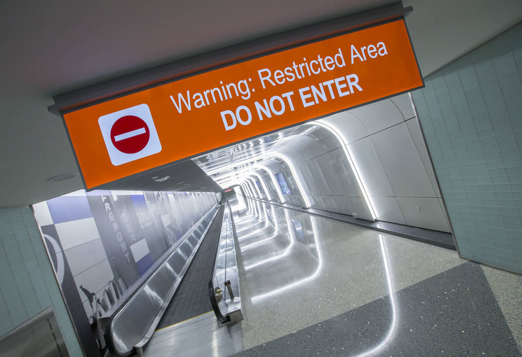 The recently completed 995-foot-long corridor linking the D-Gate Concourse to the airport's U.S. Customs and Border Protection station in Terminal 3 at McCarran International Airport in Las Vegas  ...