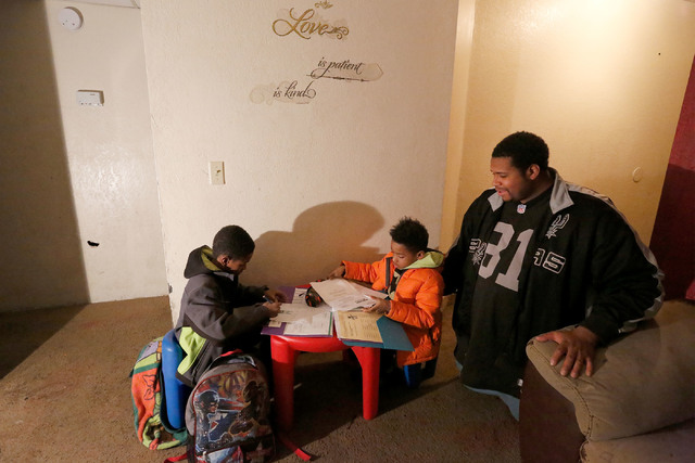 Randy Benson, who supports the Education Savings Account program, watches his sons Rashan, 8, left, and Randon, 5, at his home in Las Vegas, Tuesday, Jan. 17, 2017. (Chitose Suzuki/Las Vegas Revie ...