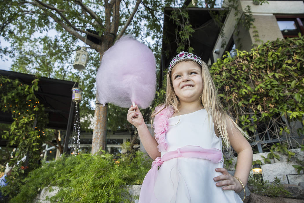 Abigail Lusher, 4, enjoys house made cotton candy at Americana on Saturday, May 20, 2017, in Las Vegas. Benjamin Hager Las Vegas Review-Journal @benjaminhphoto
