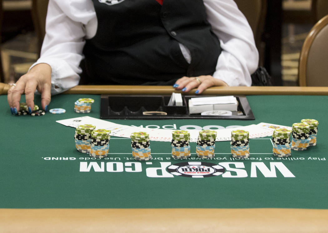 A dealer prepares for players at the Rio Convention Center on Tuesday, May 30, 2017 in Las Vegas. The 48th annual WSOP begins Wednesday and will continue for the following seven and a half weeks.  ...