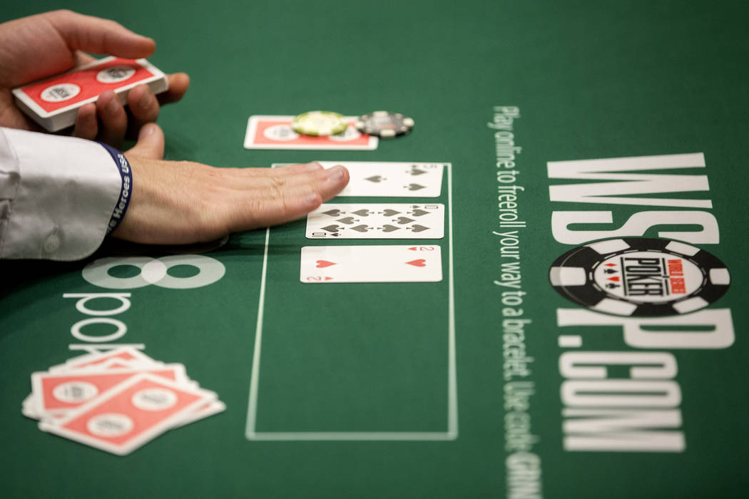 A dealer lays out cards at the Rio Convention Center on Tuesday, May 30, 2017 in Las Vegas. The 48th annual WSOP begins Wednesday and will continue for the following seven and a half weeks. Bridge ...