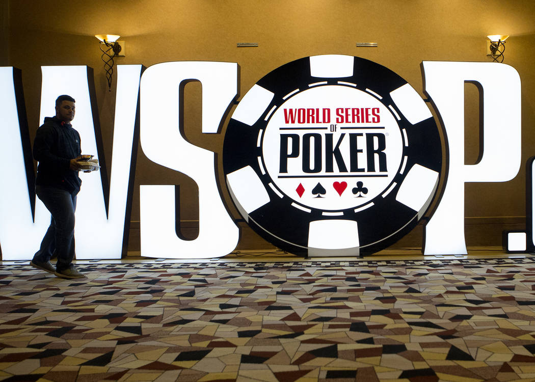 """A man walks about a """"World Series of Poker"""" sing at the Rio Convention Center on Tuesday, May 30, 2017 in Las Vegas. The 48th annual WSOP begins Wednesday and will continue for t ..."""