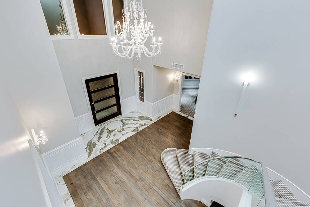Murano glass is used extensively throughout the house. Homeowner Tom Love said this one in the entry foyer cost $85,000. (The Tom Love Group)