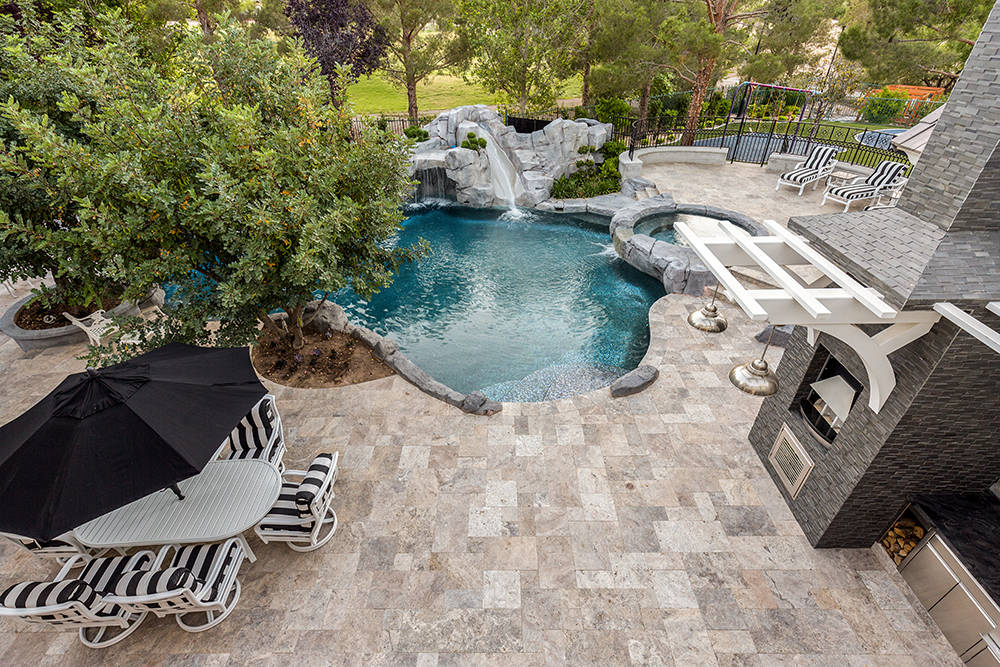 The home features a deep lagoon-style pool. (The Tom Love Group)