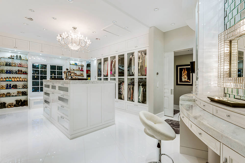 Her closet is pristine white with a crystal chandelier, mirrored subway tiles and more rhinestone and pearl embellished drawer hardware, repeating the bedrooms' Hollywood glam style. (The Tom Lo ...