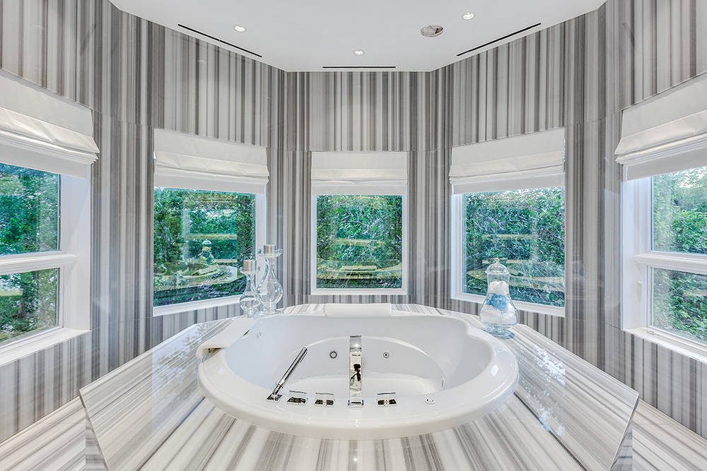 One of the master baths off the master suite. (The Tom Love Group)