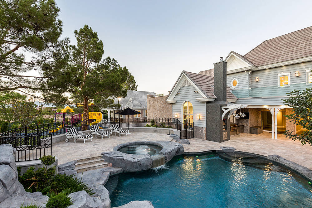The property features a deep lagoon-style pool. (The Tom Love Group)