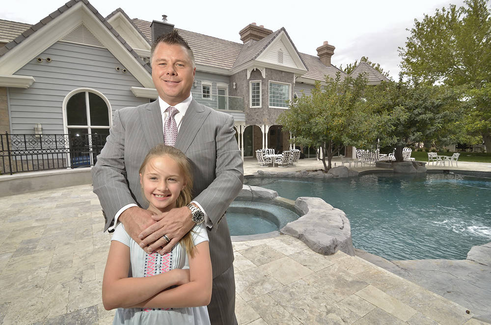 Tom Love is shown at home with his daughter Siara at his Queensridge home is listing for $8 million. (Bill Hughes/Las Vegas Business Press)