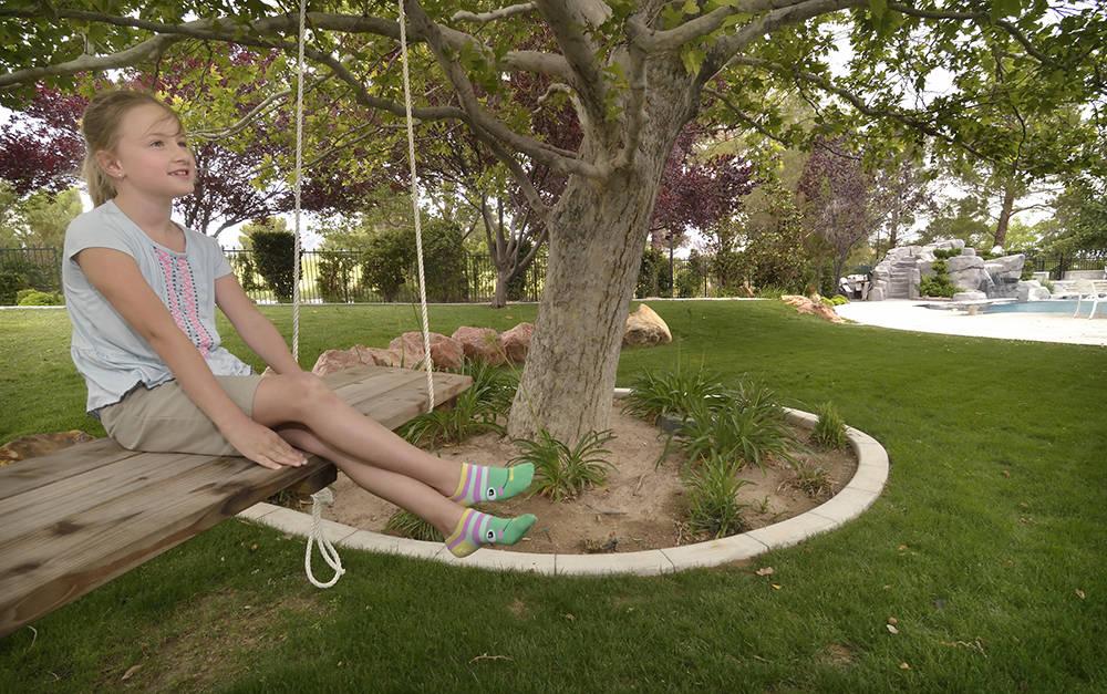 Siara Love is shown in her back yard. (Bill Hughes/Las Vegas Business Press)
