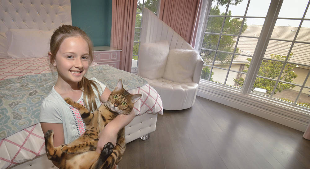 Siara Love is shown in her room with the family cat. (Bill Hughes/Las Vegas Business Press)