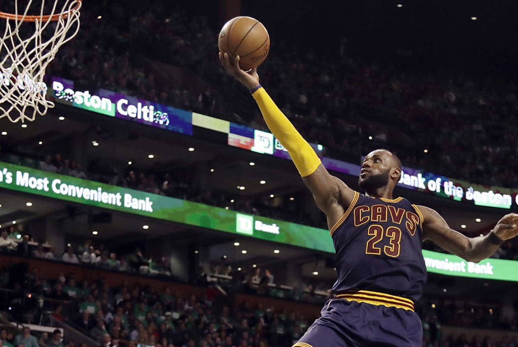 Cleveland Cavaliers forward LeBron James (23) soars to the basket over Boston Celtics forward Jae Crowder, left, and center Kelly Olynyk (41) during the second half of Game 5 of the NBA basketball ...