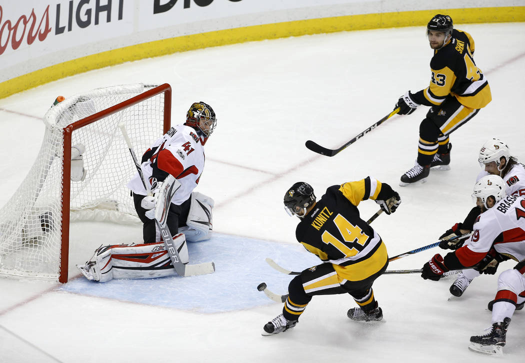 Pittsburgh Penguins left wing Chris Kunitz (14) scores a goal against Ottawa Senators goalie Craig Anderson (41) during the second period of Game 7 of the Eastern Conference final in the NHL Stanl ...
