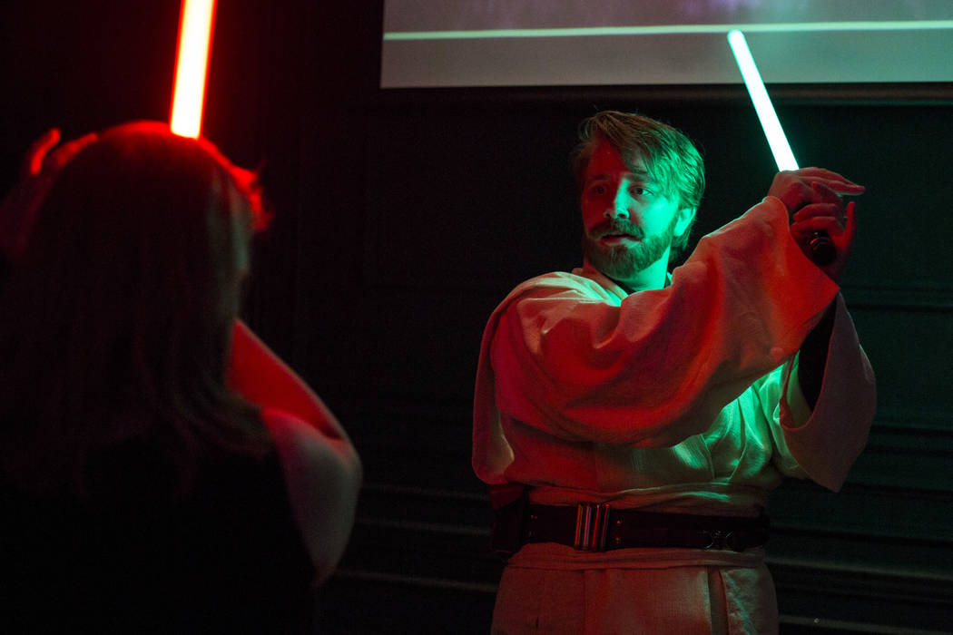 Amanda Bond, left, and Rebecca Zobell, dressed as Obi Wan Kenobi, practice their lightsaber skills as they celebrate the 40th anniversary of the release of Episode IV РA New Hope at the Mill ...