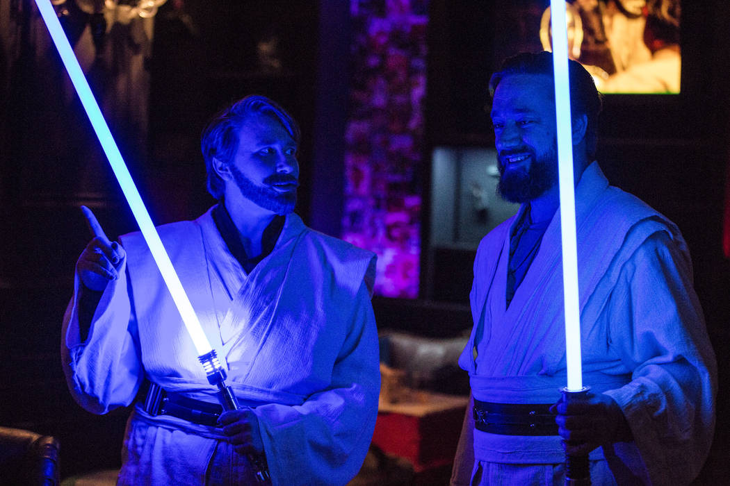 Rebecca Zobell, left, and Jack Stuart, both dressed as Obi Wan Kenobi, share a moment as they celebrate the 40th anniversary of the release of Episode IV РA New Hope at the Millennium Fandom ...