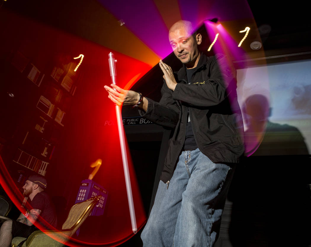 Jon Paul, who formerly played Darth Maul and a stormtrooper, shows off his lightsaber skills as he celebrates the 40th anniversary of the release of Episode IV РA New Hope at the Millennium  ...