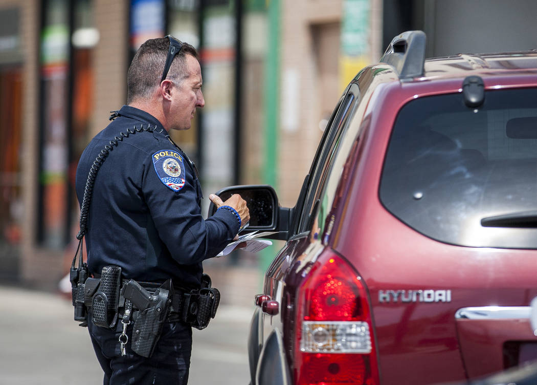 Officer Anthony Gaspardi of the Clark County School District Police gives a motorist a ticket on Nellis Boulevard on Tuesday, May 30, 2017. Multiple police departments joined together for an event ...