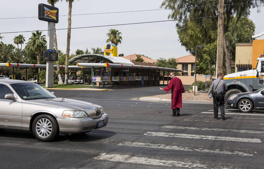 Officer Robert Mayer of the Clark County School District Police urges a motorist to slow down while crossing Nellis Boulevard in Las Vegas on Tuesday, May 30, 2017. Multiple police departments joi ...