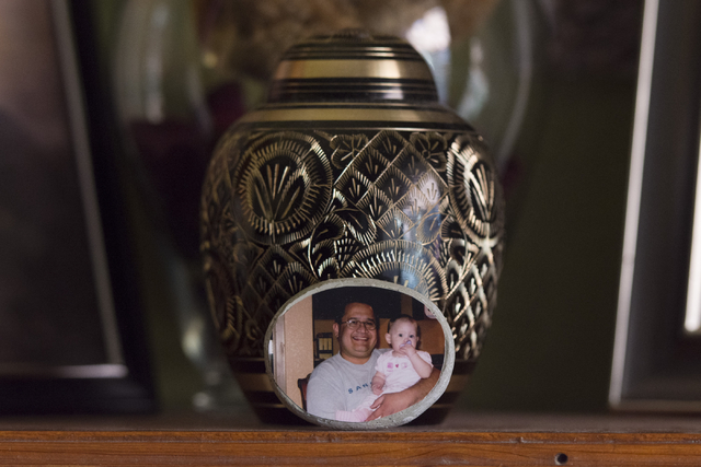 An urn holding Mark Santee's ashes sits on a shelf at his daughter Amber Santee's residence in Henderson Monday, Aug. 15, 2016. Mark Santee was randomly killed while working as a security guard at ...