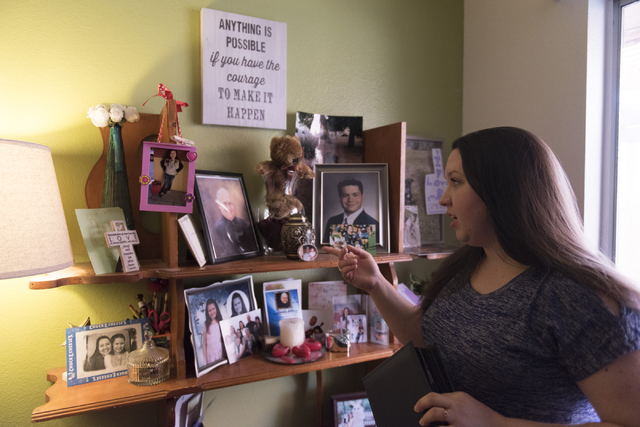 Amber Santee shows family photos at her residence in Henderson, Monday, Aug. 15, 2016. Santee's father, Mark, was randomly killed while working as a security guard at a southwest valley constructi ...