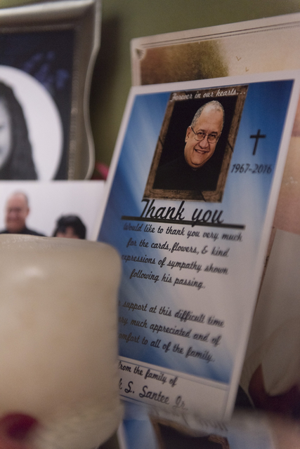 A card showing Mark Santee sits on a shelf at his daughter Amber Santee's residence in Henderson Monday, Aug. 15, 2016. Mark Santee was randomly killed while working as a security guard at a south ...