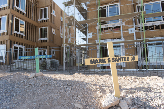 Memorial crosses which Amber Santee made for her father Mark are seen on Monday, Aug. 15, 2016. Mark was randomly killed while working as a security guard at a southwest valley construction site o ...