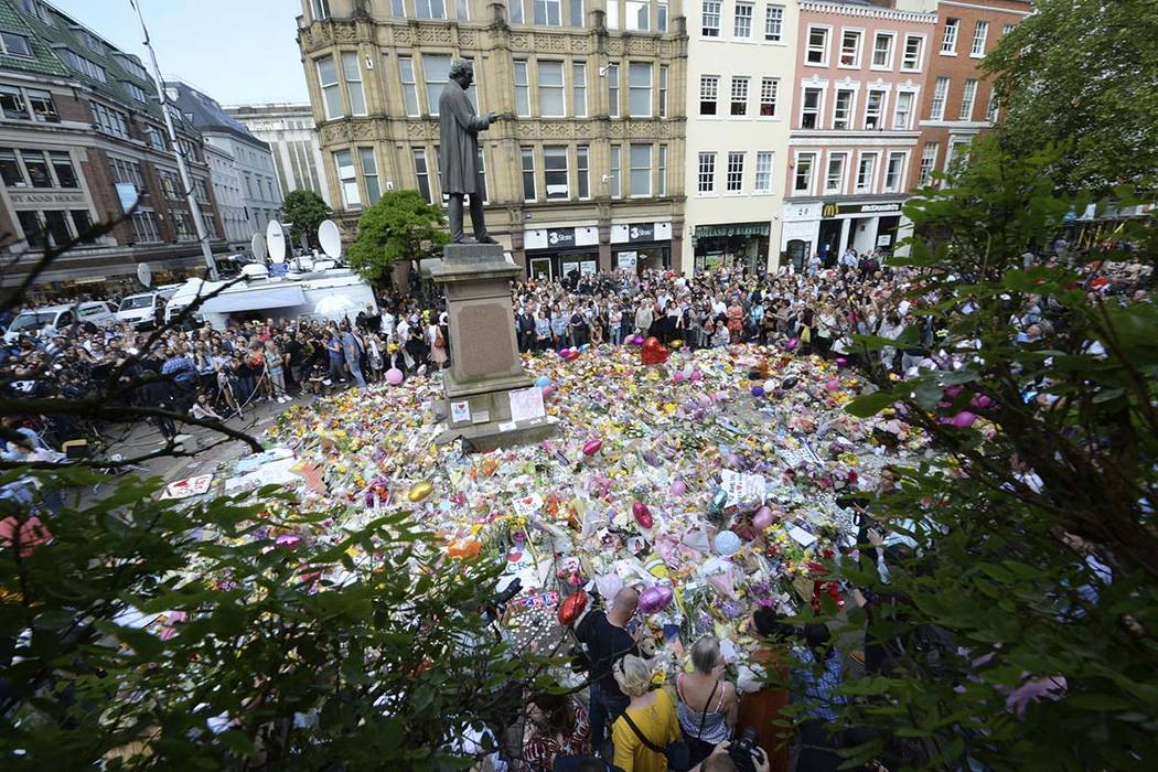 People hold a minute of silence in a square in central Manchester, England, Thursday, May 25, 2017, for the victims of the suicide attack on Monday night. (Ben Birchall/PA via AP)