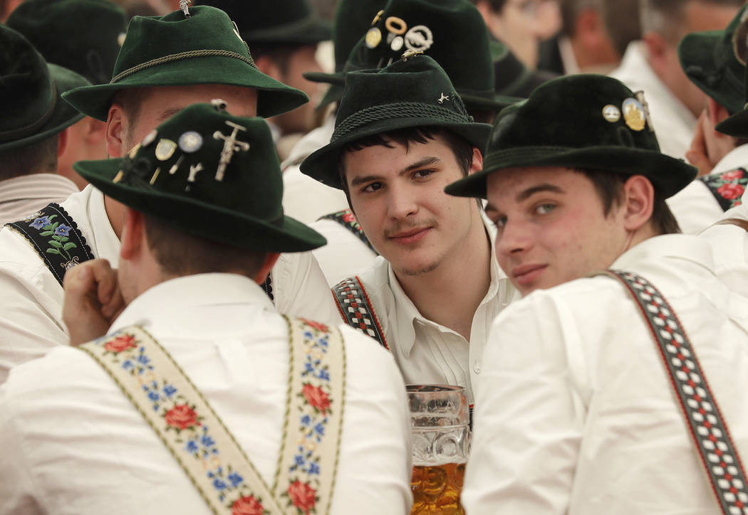 Young men dressed in traditional clothes attend the 40th Alpine Country Championships in Fingerhakeln_finger wrestling_ in Woernsmuehl, Germany, Thursday, May 25, 2017. Competitors battled for the ...