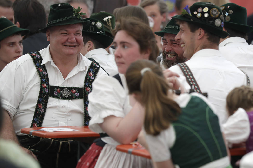 People dressed in traditional clothes attend the 40th Alpine Country Championships in Fingerhakeln_finger wrestling_ in Woernsmuehl, Germany, Thursday, May 25, 2017. Competitors battled for the ti ...