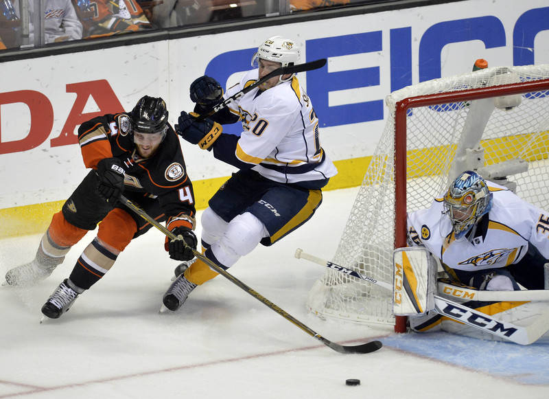 May 20, 2017; Anaheim, CA, USA; Anaheim Ducks defenseman Cam Fowler (4) moves in for a shot on goal against the defense of Nashville Predators right wing Miikka Salomaki (20) and goalie Pekka Rinn ...