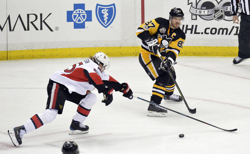 May 25, 2017; Pittsburgh, PA, USA;Pittsburgh Penguins center Sidney Crosby (87) centers the puck against Ottawa Senators defenseman Erik Karlsson (65) during the second period in game seven of the ...