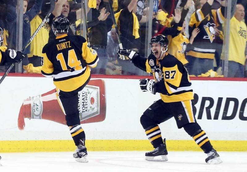 May 25, 2017; Pittsburgh, PA, USA;  Pittsburgh Penguins left wing Chris Kunitz (14) and center Sidney Crosby (87) react after Kunitz scored a goal in double overtime against the Ottawa Senators to ...