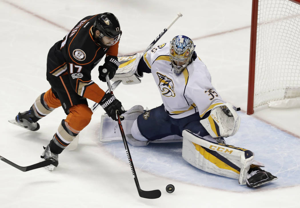 Anaheim Ducks center Ryan Kesler misses a shot against Nashville Predators goalie Pekka Rinne during the first period of Game 5 in the NHL hockey Stanley Cup Western Conference finals in Anaheim,  ...