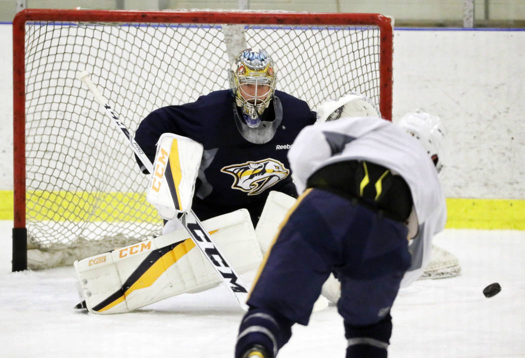 Nashville Predators goalie Pekka Rinne, of Finland, watches a shot during practice at the team's NHL hockey facility Thursday, May 25, 2017, in Nashville, Tenn. (AP Photo/Mark Humphrey)