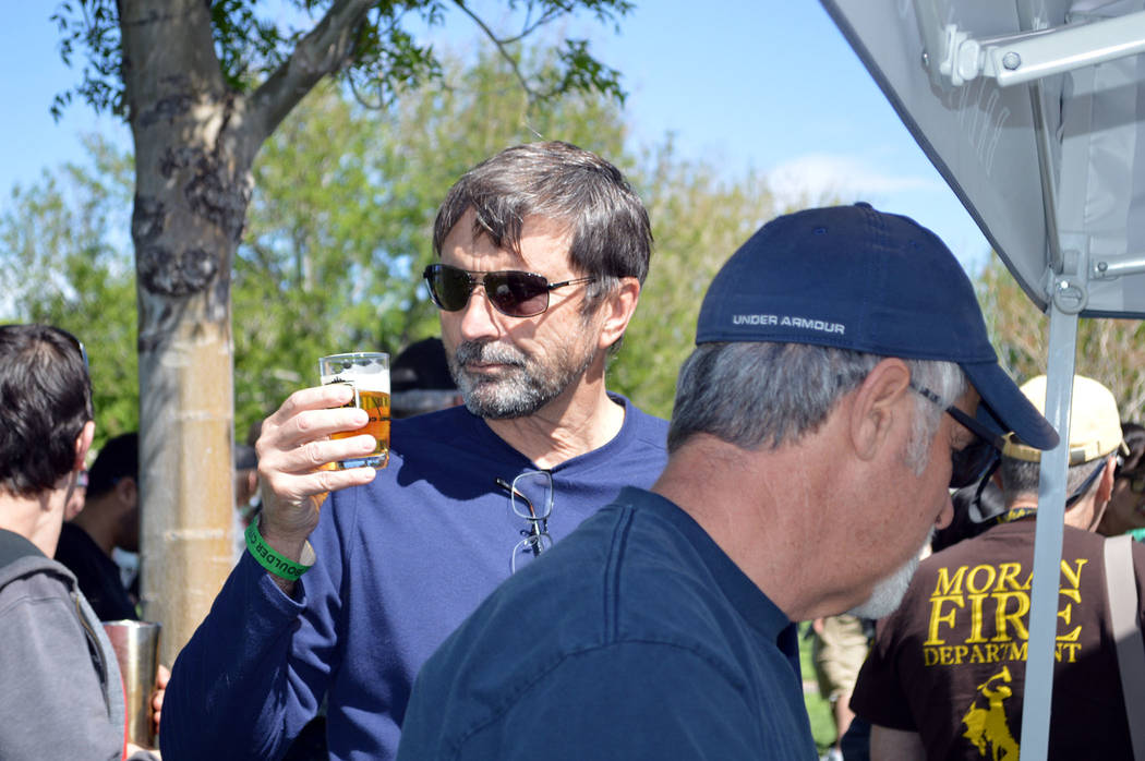 Lorne Caddick examines the beer he is about to sample at Saturday's beer fest held in Wilbur Square Park. Celia Shortt Goodyear/Boulder City Review