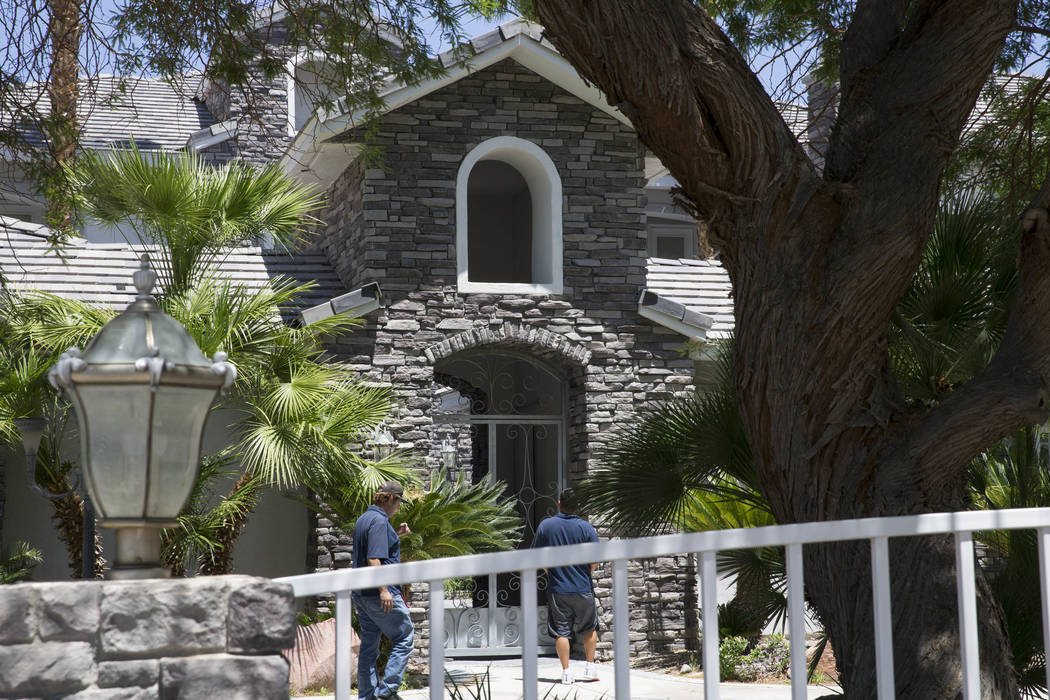 Two men attempt to enter the home of former Strip illusionist Jan Rouven, located at 7080 Donald Nelson Ave. near North Tenaya Way in Las Vegas, on Friday, May 26, 2017. Richard Brian Las Vegas Re ...