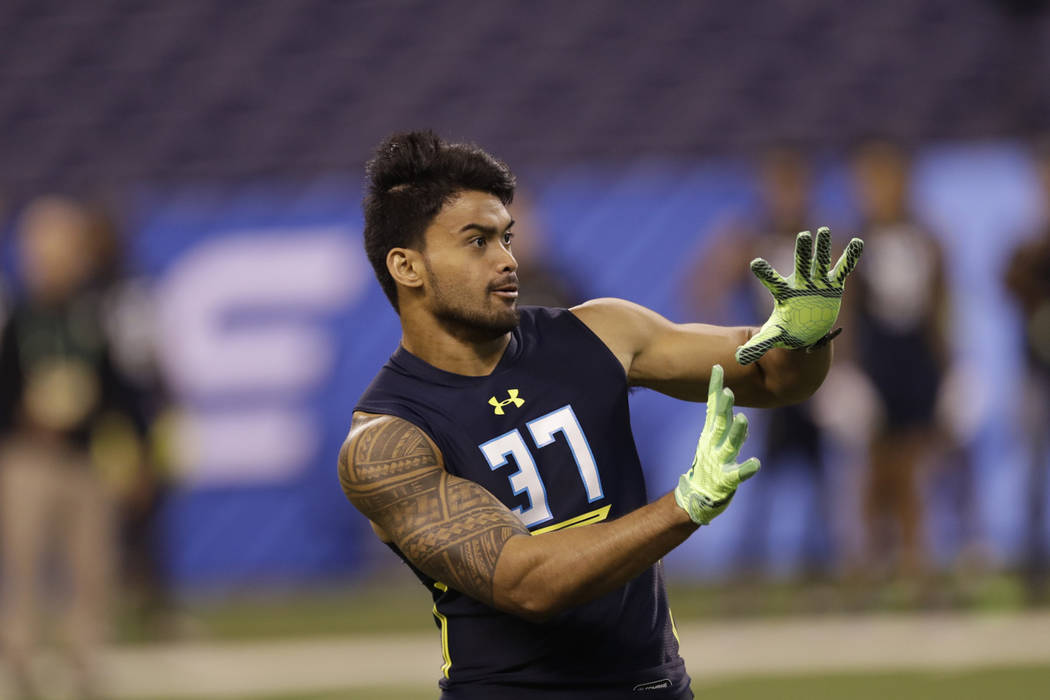Washington State defensive back Shalom Luani runs a drill at the NFL football scouting combine Monday, March 6, 2017, in Indianapolis. (AP Photo/David J. Phillip)