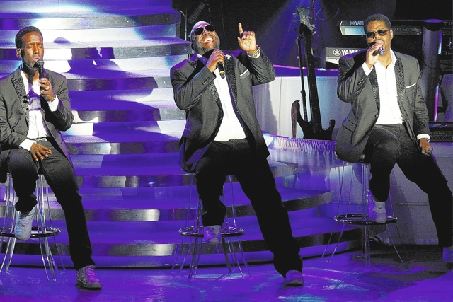 Singers Shawn Stockman, Wanya Morris and Nathan Morris of Boyz II Men perform during their show at Terry Fator Theater at The Mirage on Sunday, Nov. 9, 2014, in Las Vegas. (Erik Verduzco/Las Vegas ...