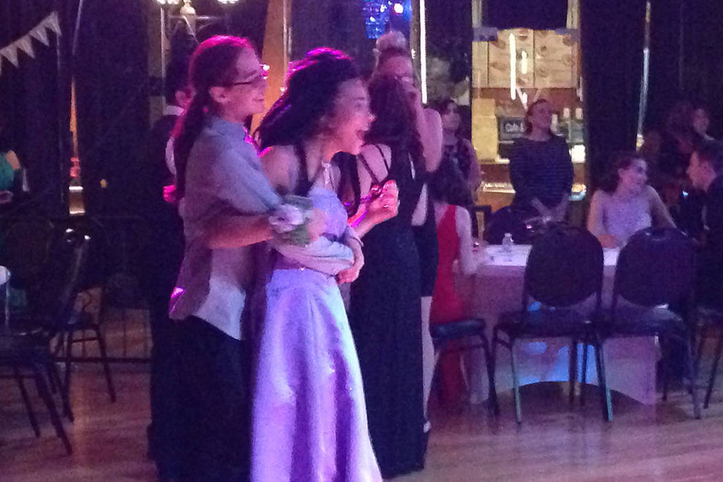 Bree Achong talks with her date during Nevada Virtual Academy's prom on Saturday, May 27, 2017 at VZ Dance Studios in Las Vegas. Achong and other students attend all of their classes virtually and ...