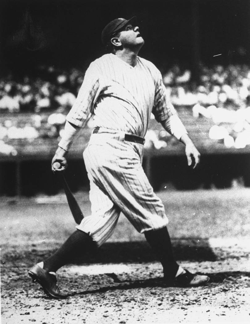 Babe Ruth is shown lofting another home run into the right field upper deck at Yankee Stadium on the way to his 60-homer year of 1927.  (AP Photo/National Baseball Library, Cooperstown, N.Y.)