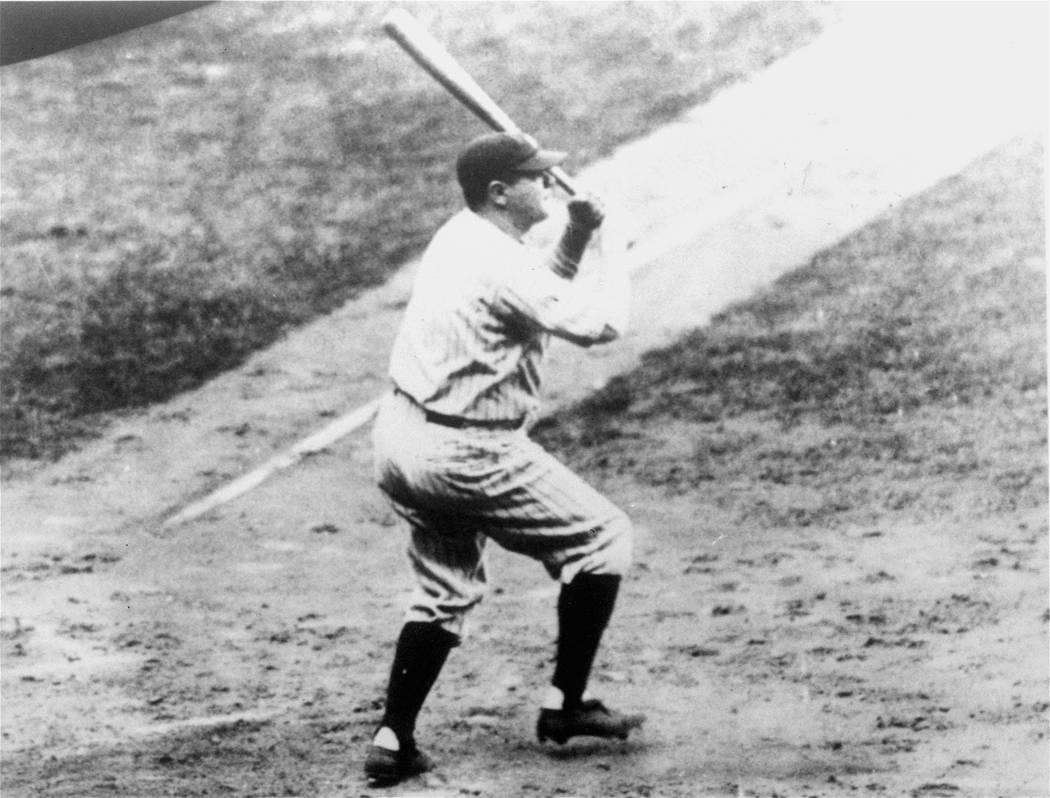 Babe Ruth of the New York Yankees hits his record-breaking 60th home run on September 30, 1927, off Tom Zachary of the Washington Senators. (AP Photo)
